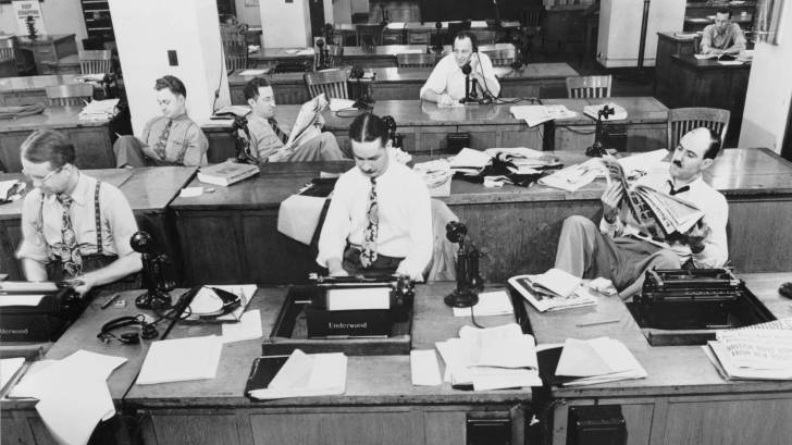 old photo of the NYT news room with older men