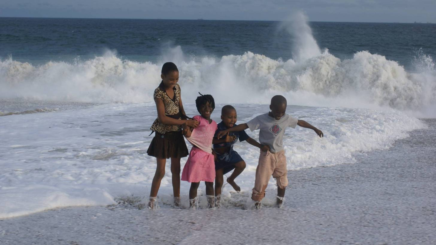 happy children splashing in the ocean
