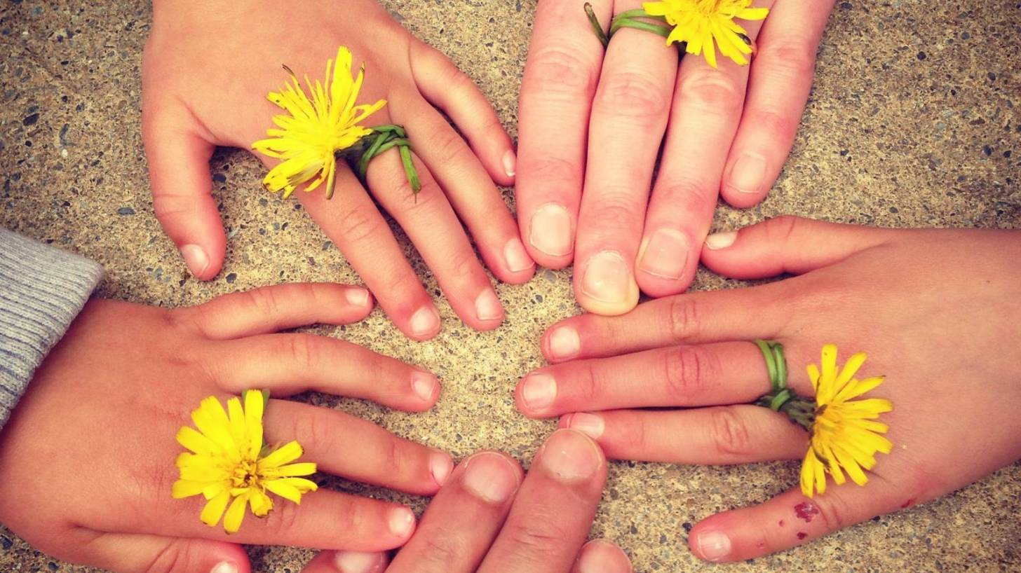 family hand touching each other keeping healthy