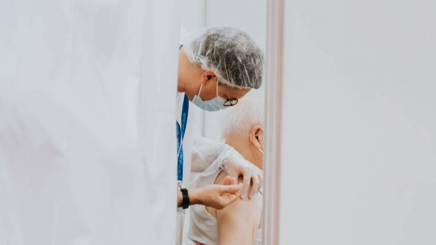 man getting a vaccine