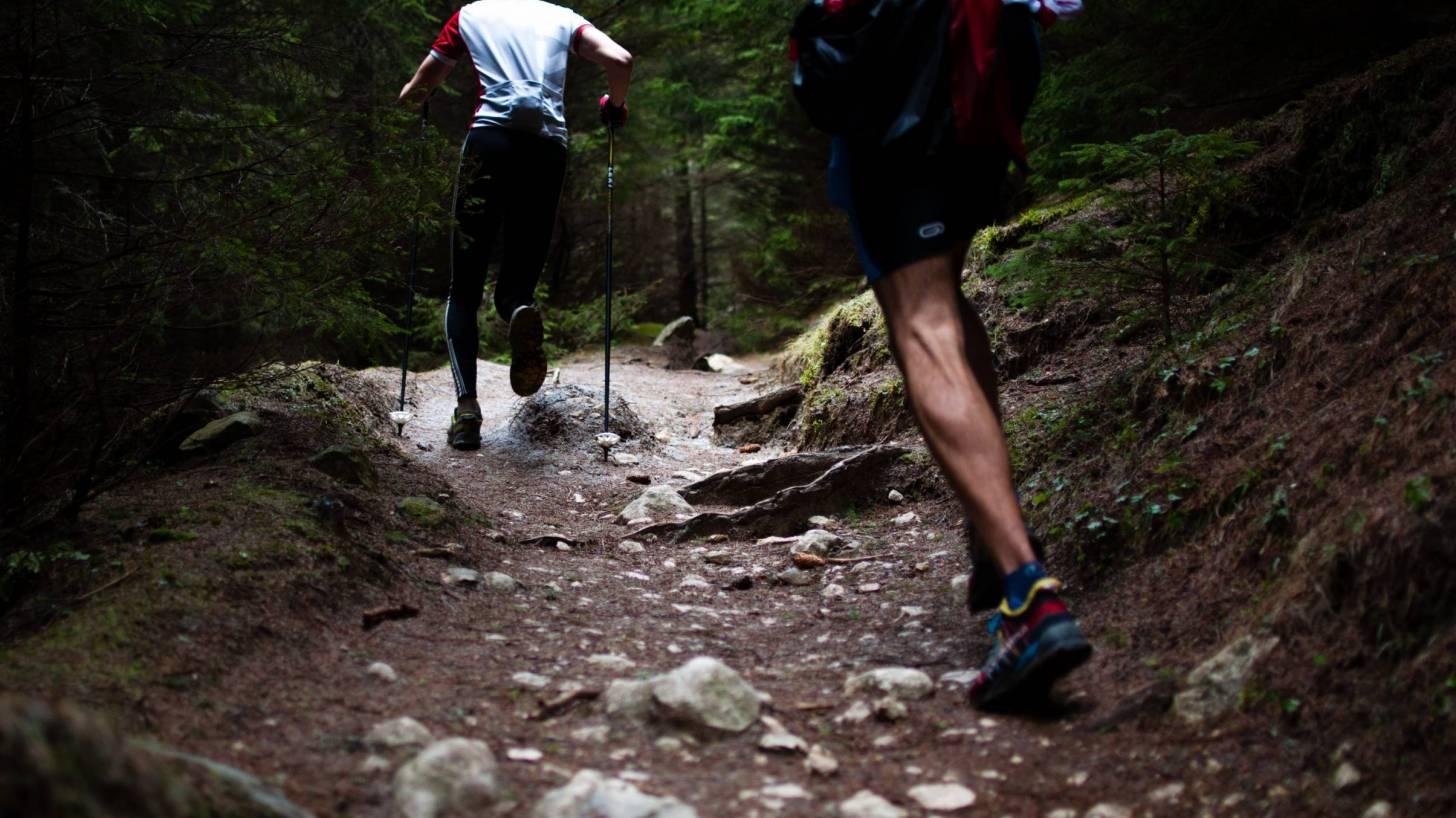 men running a trail