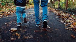 dad and son walking along a trail