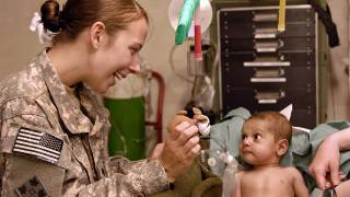 army doc helping a little toddler