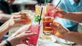 people cheers with drinks