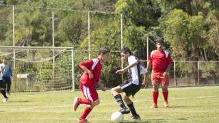 teens palying soccer