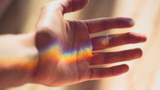 rainbow light on a hand