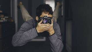 man taking a photo with camera