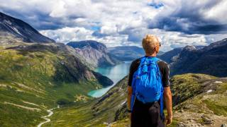 norway mountains with a hiker looking into the sky