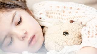 young sleeping little girl with Teddy bear