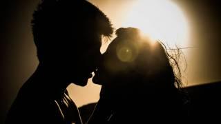sunset couple kissing