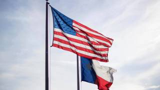 american and texas flags