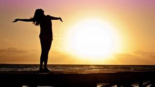 woman celebrating the sunrise