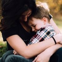 mom holding sick son