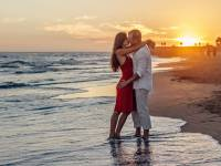 couple hugging on the beach