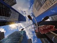 city scape with stop sign