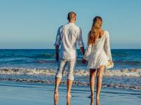 young couple looking at the surf